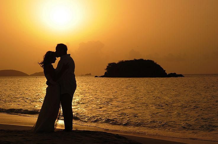 Romance at a sunset beach- wedding